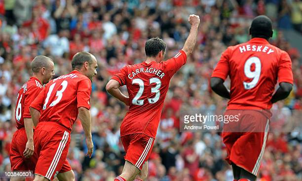 Jamie Carragher of Liverpool celebrates after scoring a penalty during Jamie Carragher's Testimonial Match between Liverpool v Everton at Anfield on...