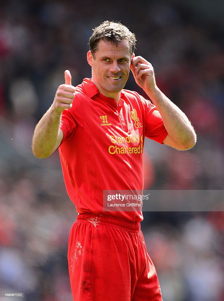 Jamie Carragher of Liverpool gives a thumbs up during the Barclays Premier League match between Liverpool and Everton at Anfield on May 5, 2013 in Liverpool, England.