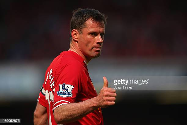 Jamie Carragher of Liverpool gives a thumbs up during the Barclays Premier League match between Liverpool and Queens Park Rangers at Anfield on May...