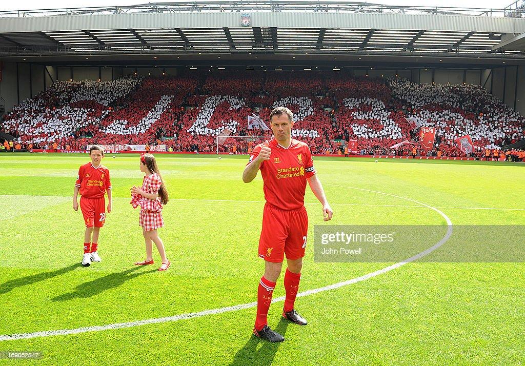 Jamie Carragher of Liverpool gives the thumbs up before the Barclays Premier League match between Liverpool and Queens Park Rangers at Anfield on May 19, 2013 in Liverpool England.