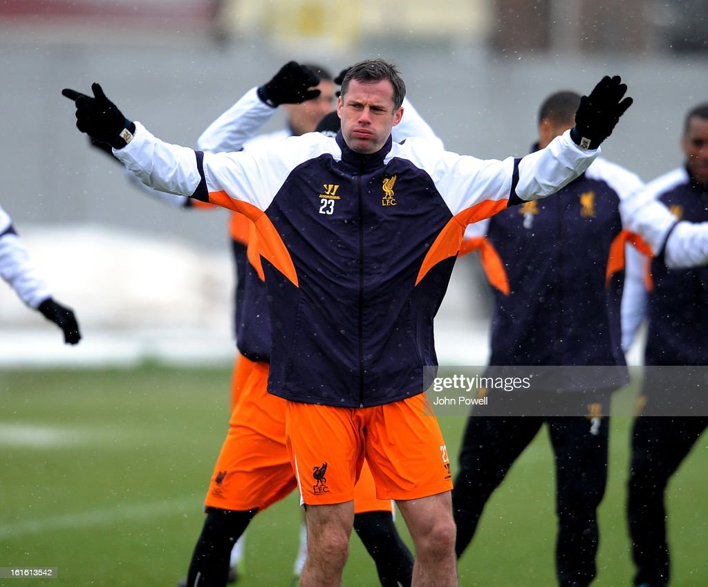Jamie Carragher of Liverpool in action during a training session at Melwood Training Ground on February 13, 2013 in Liverpool, England.