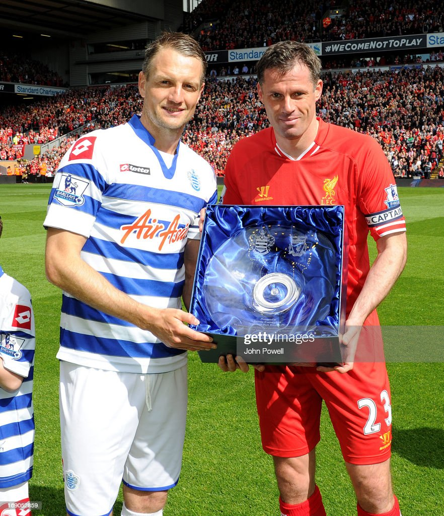 <a gi-track='captionPersonalityLinkClicked' href=/galleries/search?phrase=Jamie+Carragher&family=editorial&specificpeople=206485 ng-click='$event.stopPropagation()'>Jamie Carragher</a> of Liverpool is given a commemorative award before the Barclays Premier League match between Liverpool and Queens Park Rangers at Anfield on May 19, 2013 in Liverpool England.