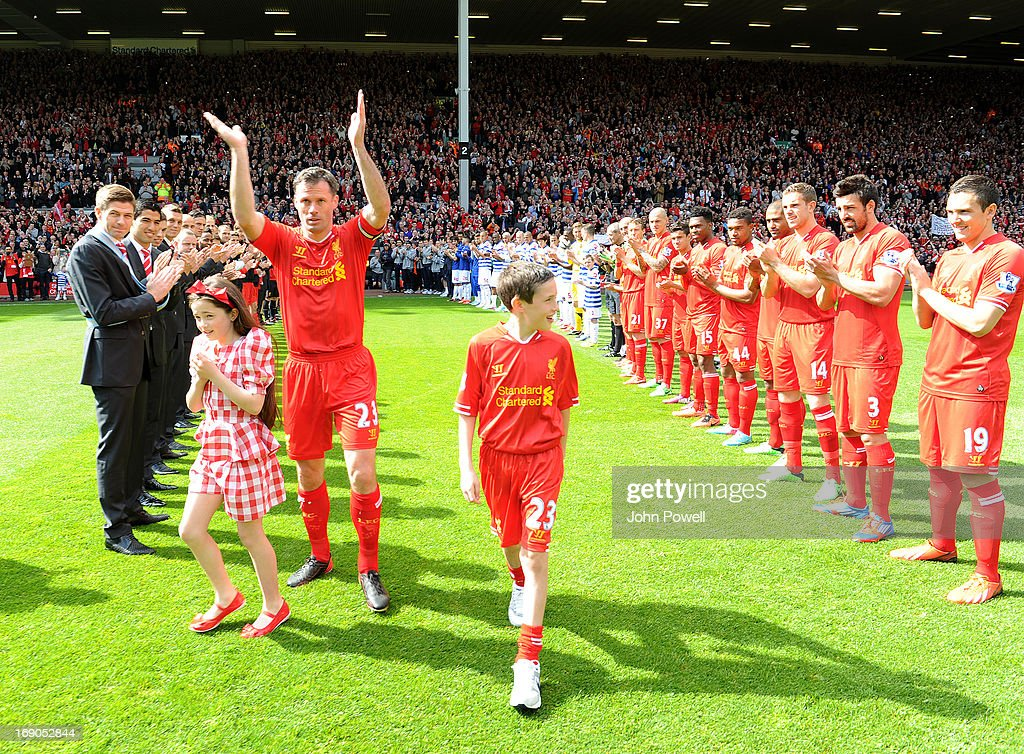 <a gi-track='captionPersonalityLinkClicked' href=/galleries/search?phrase=Jamie+Carragher&family=editorial&specificpeople=206485 ng-click='$event.stopPropagation()'>Jamie Carragher</a> of Liverpool is given a guard of honour before the Barclays Premier League match between Liverpool and Queens Park Rangers at Anfield on May 19, 2013 in Liverpool England.