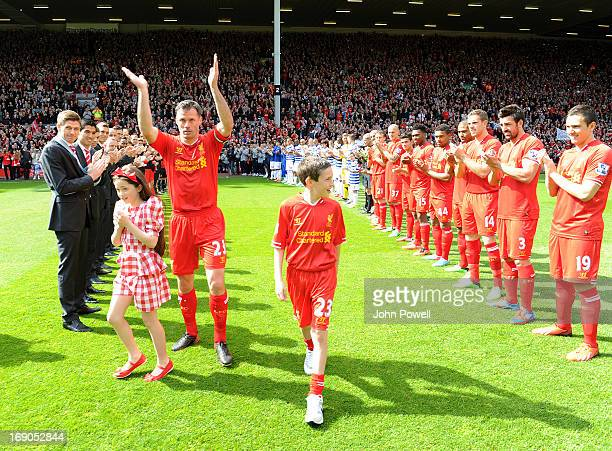 Jamie Carragher of Liverpool is given a guard of honour before the Barclays Premier League match between Liverpool and Queens Park Rangers at Anfield...