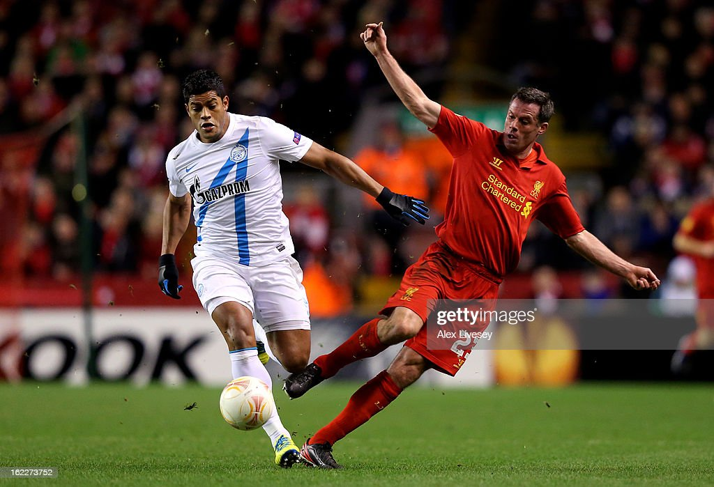 <a gi-track='captionPersonalityLinkClicked' href=/galleries/search?phrase=Jamie+Carragher&family=editorial&specificpeople=206485 ng-click='$event.stopPropagation()'>Jamie Carragher</a> of Liverpool makes an ill timed back pass to allow Hulk of Zenit to score the opening oal during the UEFA Europa League round of 32 second leg match between Liverpool FC and FC Zenit St Petersburg at Anfield on February 21, 2013 in Liverpool, England.
