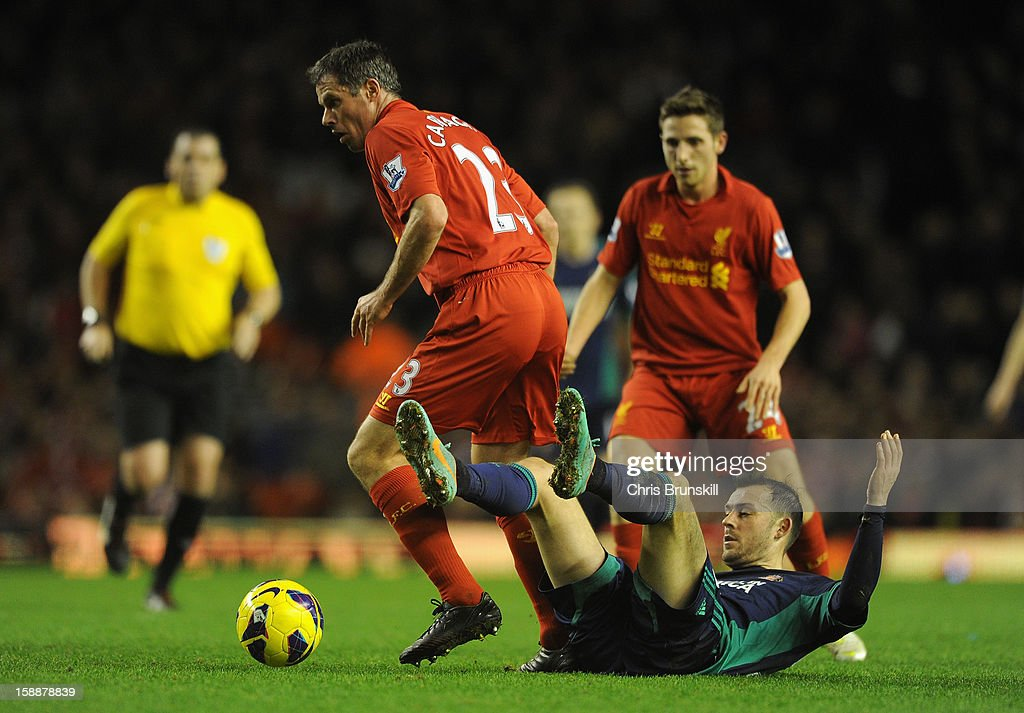 Jamie Carragher of Liverpool tangles with Steven Fletcher of Sunderland during the Barclays Premier League match between Liverpool and Sunderland at Anfield on January 2, 2013 in Liverpool, England.