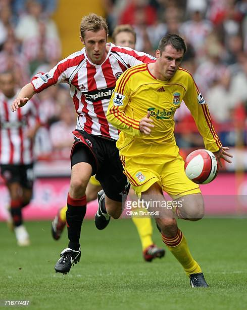 Jamie Carragher of Liverpool tussles for posession with Rob Hulse of Sheffield United during the Barclays Premiership match between Sheffield United...