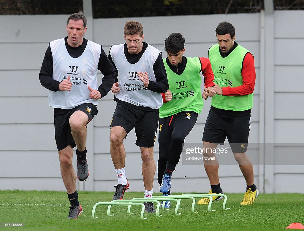 Jamie Carragher, Steven Gerrard, Suso and Jose Enrique of Liverpool in aciton during a training session at Melwood Training Ground on April 25, 2013 in Liverpool, England.