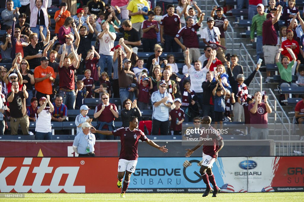 Jamie Castrillon of Colorado Rapids with teammate Omar Cummings after scoring a goal against Los Angeles Galaxy during their MLS match at Dick's...