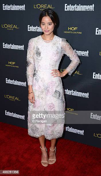 Jamie Chung attends the 2014 Entertainment Weekly PreEmmy Party at Fig Olive Melrose Place on August 23 2014 in West Hollywood California