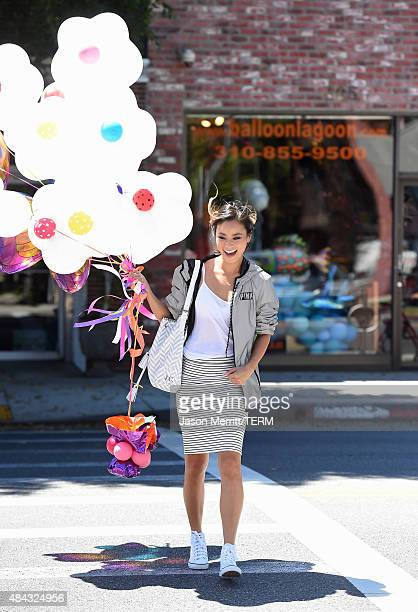 Jamie Chung wearing Victoria's Secret PINK limited release anorak while shopping on August 12 2015 in Beverly Hills California