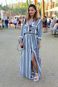 Jamie Chung wears Teva Flatform Universal Sandals to the 2015 Coachella Valley Music Festival at the Empire Polo Fields on April 12 2015 in Indio...