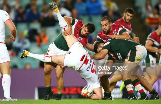 Jamie Clark of Lebanon up ends Sean O'Loughlin of England during the 2017 Rugby League World Cup match between England and Lebanon at Allianz Stadium...