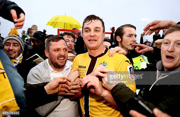 Jamie Collins of Sutton United celebrates with the Sutton United fans after the Emirates FA Cup Fourth Round match between Sutton United and Leeds...