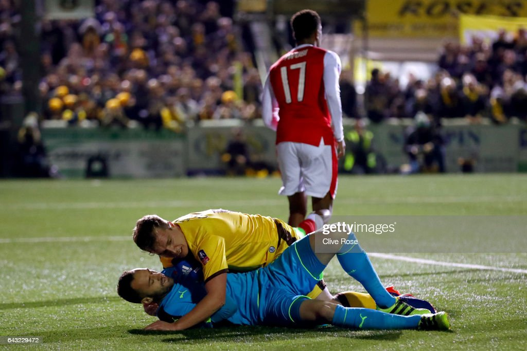 Jamie Collins of Sutton United collides with David Ospina of Arsenal during the Emirates FA Cup fifth round match between Sutton United and Arsenal on February 20, 2017 in Sutton, Greater London.