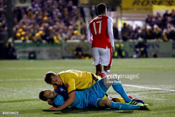Jamie Collins of Sutton United collides with David Ospina of Arsenal during the Emirates FA Cup fifth round match between Sutton United and Arsenal...