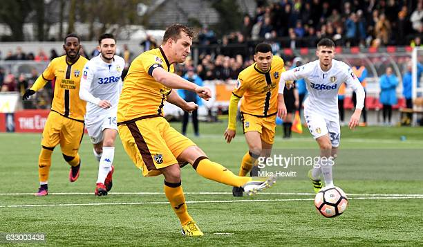 Jamie Collins of Sutton United scores his sides first goal from the penalty spot during The Emirates FA Cup Fourth Round match between Sutton United...