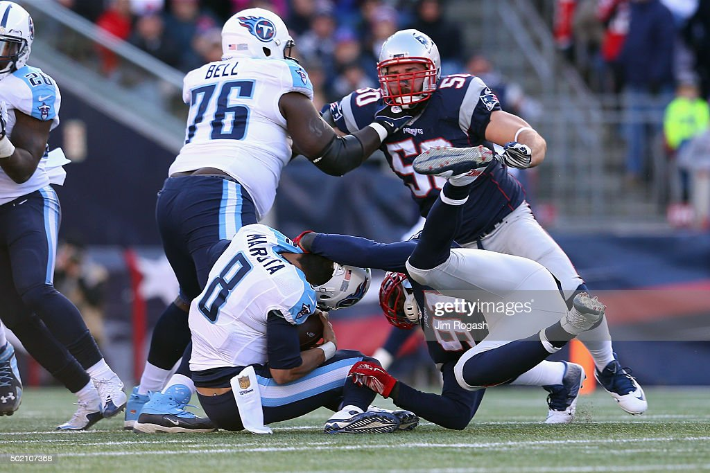 Jamie Collins #91 of the New England Patriots sacks Marcus Mariota #8 of the Tennessee Titans during the first half at Gillette Stadium on December 20, 2015 in Foxboro, Massachusetts.