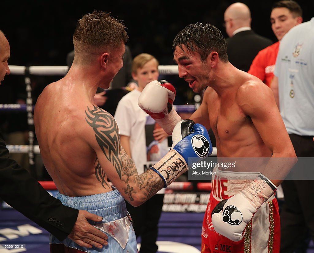 Jamie Conlan (red and white shorts) celebrates victory over Anthony Nelson (claret and blue shorts) after the Commonwealth Super Flyweight Championship contest between Anthony Nelson and Jamie Conlan at Copper Box Arena on April 30, 2016 in London, England.