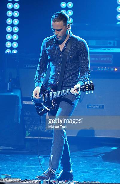 Jamie Cook of Arctic Monkeys performs onstage during iHeartRadio Live Series With Arctic Monkeys held at iHeartRadio Theater on June 11 2014 in...