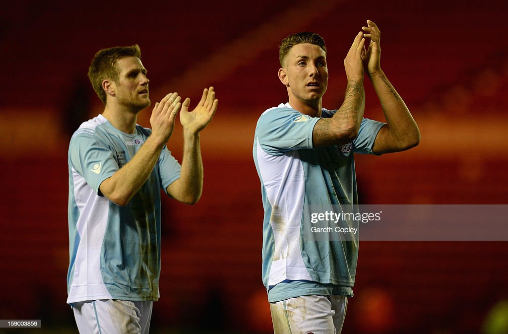 Jamie Crelin and Danny Ellis of Hastings salute their fans after the FA Cup with Budweiser Third Round match between Middlesbrough and Hastings United at Riverside Stadium on January 5, 2013 in Middlesbrough, England.