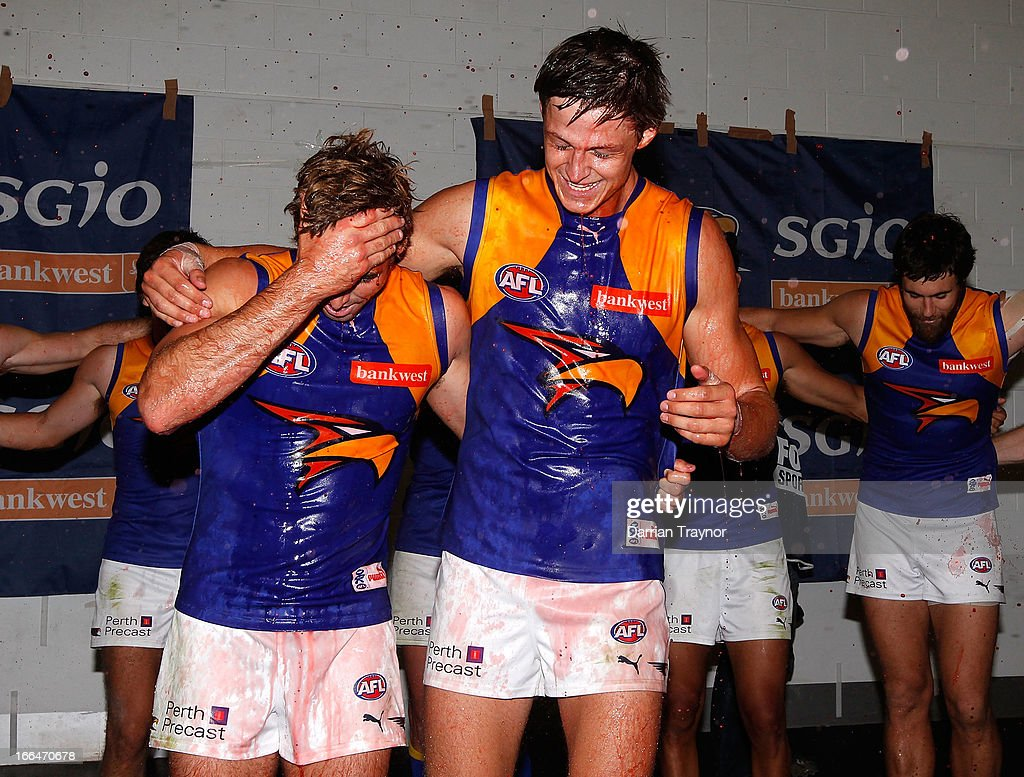 Jamie Cripps and Callum Sinclair of the Eagles are showered by team mates after the round three AFL match between the Melbourne Demons and the West Coast Eagles at Melbourne Cricket Ground on April 13, 2013 in Melbourne, Australia.