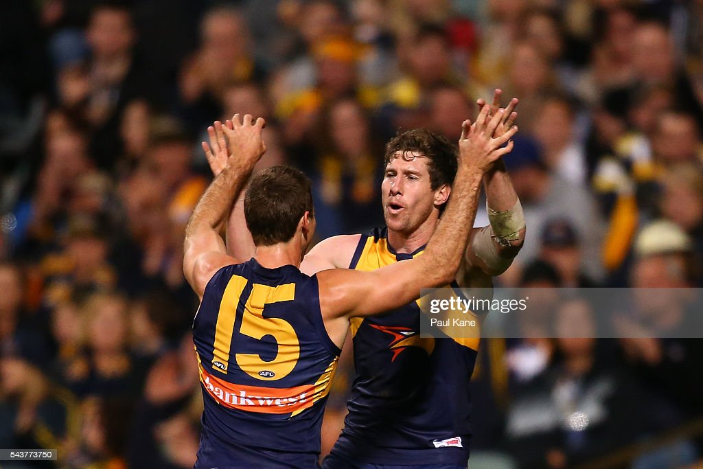 Jamie Cripps of the Eagles and Patrick McGinnity of the Eagles celebraste a goal during the round 15 AFL match between the West Coast Eagles and the Essendon Bombers at Domain Stadium on June 30, 2016 in Perth, Australia.