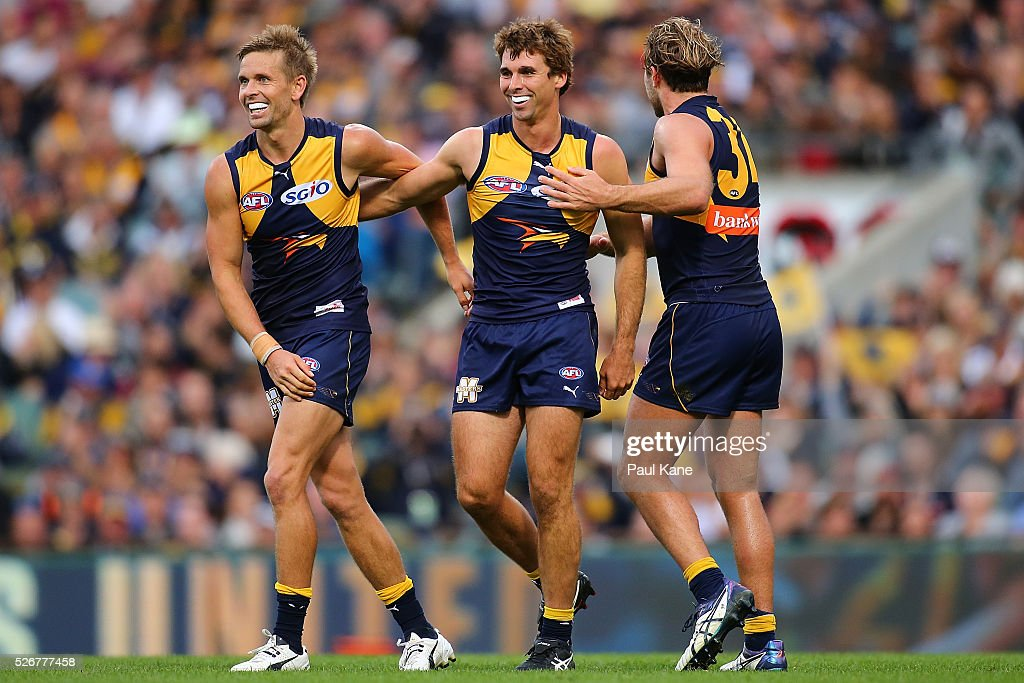 Jamie Cripps of the Eagles celebrates a goal with Mark LeCras and Mark Hutchings during the round six AFL match between the West Coast Eagles and the Collingwood Magpies at Domain Stadium on May 1, 2016 in Perth, Australia.