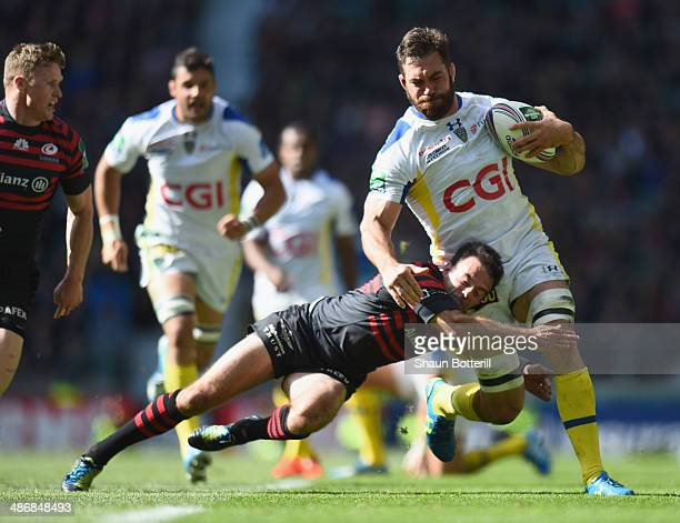 Jamie Cudmore of ASM Clermont Auvergne is tackled by Neil de Kock of Saracens during the Heineken Cup SemiFinal match between Saracens and ASM...