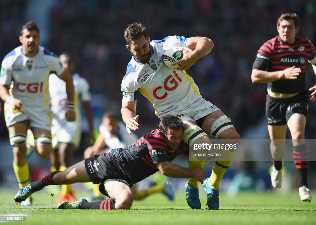 <a gi-track='captionPersonalityLinkClicked' href=/galleries/search?phrase=Jamie+Cudmore&family=editorial&specificpeople=2160348 ng-click='$event.stopPropagation()'>Jamie Cudmore</a> of ASM Clermont Auvergne is tackled by <a gi-track='captionPersonalityLinkClicked' href=/galleries/search?phrase=Neil+de+Kock&family=editorial&specificpeople=4220314 ng-click='$event.stopPropagation()'>Neil de Kock</a> of Saracens during the Heineken Cup Semi-Final match between Saracens and ASM Clermont Auvergne at Twickenham Stadium on April 26, 2014 in London, England.