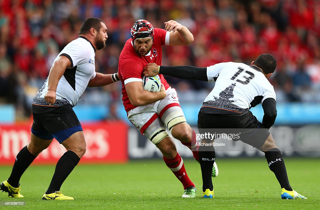 <a gi-track='captionPersonalityLinkClicked' href=/galleries/search?phrase=Jamie+Cudmore&family=editorial&specificpeople=2160348 ng-click='$event.stopPropagation()'>Jamie Cudmore</a> of Canada goes between Otar Turashvili (L) and <a gi-track='captionPersonalityLinkClicked' href=/galleries/search?phrase=Paula+Kinikinilau&family=editorial&specificpeople=6312833 ng-click='$event.stopPropagation()'>Paula Kinikinilau</a> of Romania during the 2015 Rugby World Cup Pool D match between Canada and Romania at Leicester City Stadium on October 6, 2015 in Leicester, United Kingdom.