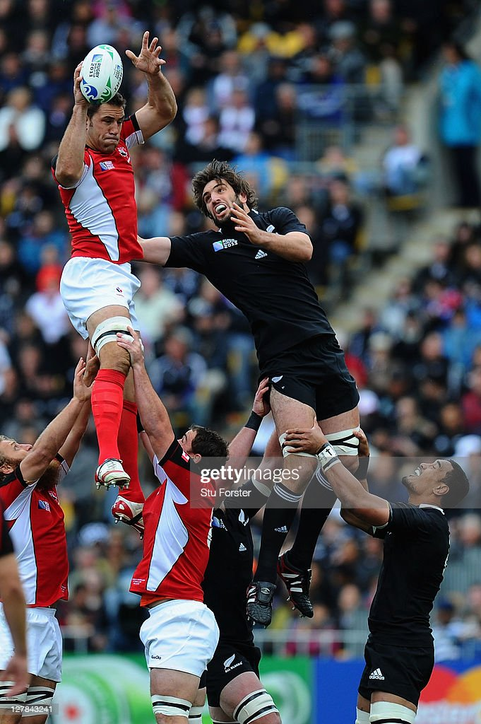 <a gi-track='captionPersonalityLinkClicked' href=/galleries/search?phrase=Jamie+Cudmore&family=editorial&specificpeople=2160348 ng-click='$event.stopPropagation()'>Jamie Cudmore</a> of Canada wins lineout ball under pressure from <a gi-track='captionPersonalityLinkClicked' href=/galleries/search?phrase=Sam+Whitelock&family=editorial&specificpeople=6070892 ng-click='$event.stopPropagation()'>Sam Whitelock</a> of the All Blacks during the IRB Rugby World Cup Pool A match between New Zealand and Canada at Wellington Regional Stadium on October 2, 2011 in Wellington, New Zealand.