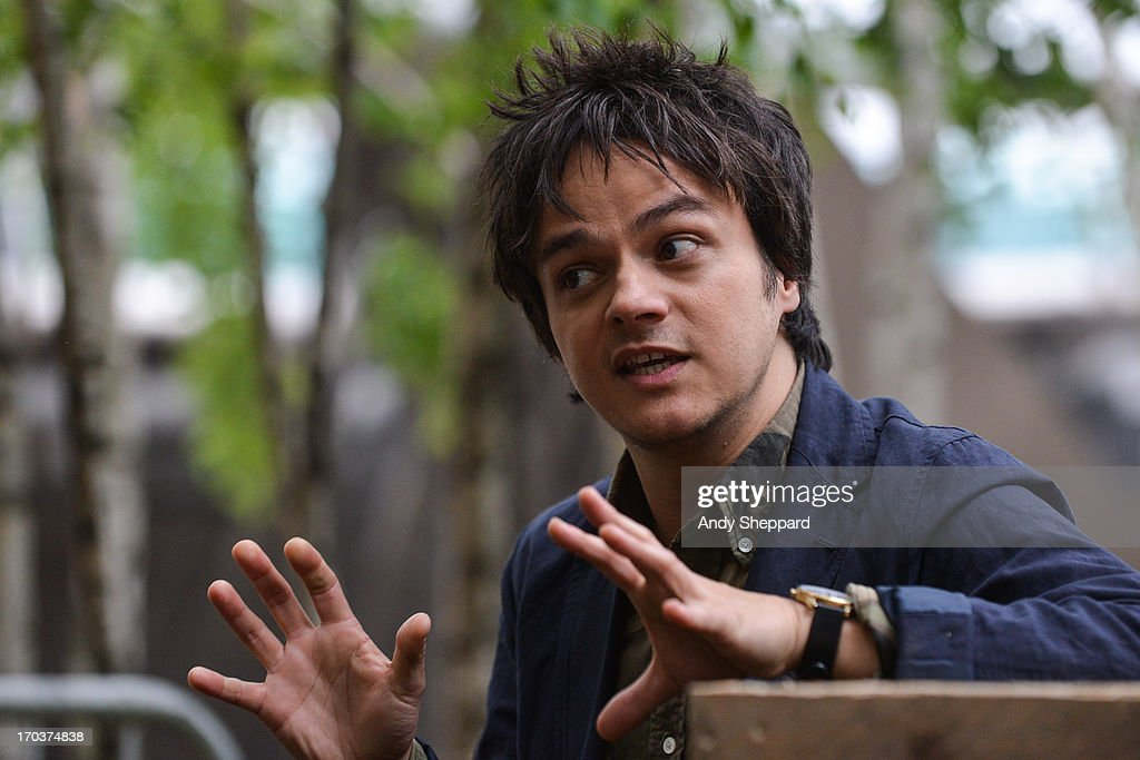 Jamie Cullum holds an interview backstage in support of One campaign's agit8 event at Tate Modern on June 13, 2013 in London, England.