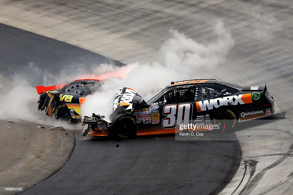 Jamie Dick, driver of the #55 Viva Auto Group Chevrolet, collides with <a gi-track='captionPersonalityLinkClicked' href=/galleries/search?phrase=Nelson+Piquet+Jr.+-+Born+1985&family=editorial&specificpeople=235640 ng-click='$event.stopPropagation()'>Nelson Piquet Jr.</a>, driver of the #30 Worx Chevrolet, after an incident in the NASCAR Nationwide Series Jeff Foxworthy's Grit Chips 300 at Bristol Motor Speedway on March 16, 2013 in Bristol, Tennessee.