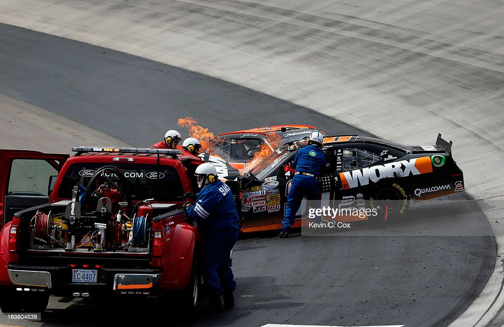 Jamie Dick, driver of the #55 Viva Auto Group Chevrolet, collides with Nelson Piquet Jr., driver of the #30 Worx Chevrolet, after an incident in the NASCAR Nationwide Series Jeff Foxworthy's Grit Chips 300 at Bristol Motor Speedway on March 16, 2013 in Bristol, Tennessee.