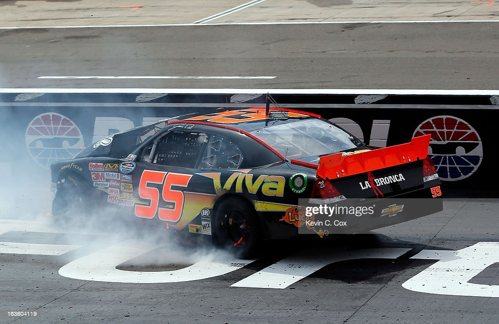 Jamie Dick, driver of the #55 Viva Auto Group Chevrolet, hits the wall after an incident in the NASCAR Nationwide Series Jeff Foxworthy's Grit Chips 300 at Bristol Motor Speedway on March 16, 2013 in Bristol, Tennessee.