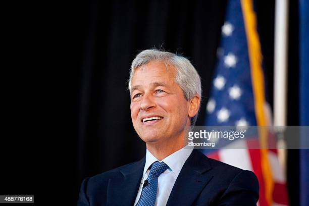 Jamie Dimon chairman and chief executive officer of JPMorgan Chase Co smiles while speaking at the Detroit Economic Club in Detroit Michigan US on...