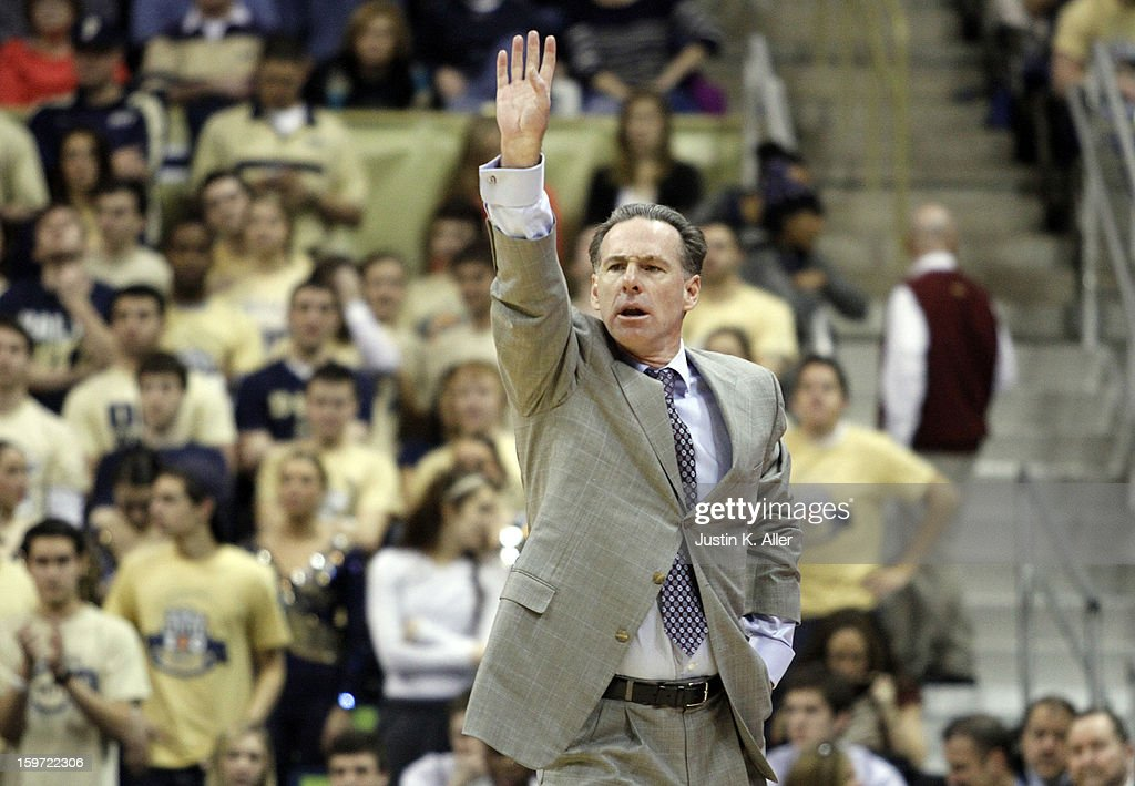 <a gi-track='captionPersonalityLinkClicked' href=/galleries/search?phrase=Jamie+Dixon&family=editorial&specificpeople=234974 ng-click='$event.stopPropagation()'>Jamie Dixon</a> head coach of the Pittsburgh Panthers directs his team against the Connecticut Huskies at Petersen Events Center on January 19, 2013 in Pittsburgh, Pennsylvania.