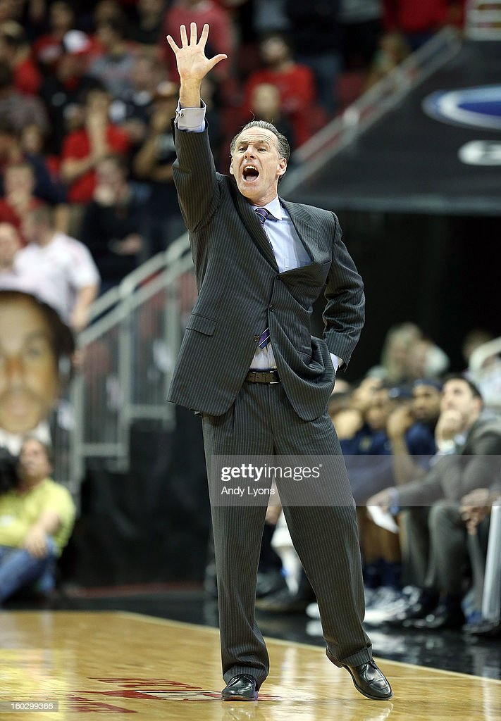 Jamie Dixon the head coach of the Pittsburgh Panthers gives instructions to his team during the game against the Louisville Cardinals at KFC YUM! Center on January 28, 2013 in Louisville, Kentucky.
