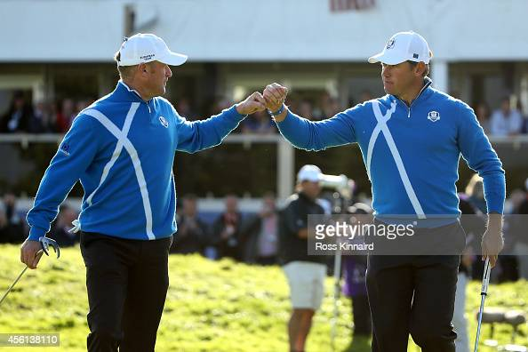 Jamie Donaldson and Lee Westwood of Europe celebrate as they leave the 12th green during the Afternoon Foursomes of the 2014 Ryder Cup on the PGA...