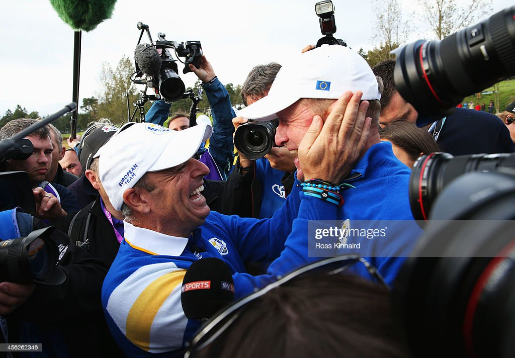 Jamie Donaldson of Europe and Europe team captain Paul McGinley celebrate on the 15th hole after Europe won the Ryder Cup with Donaldson defeating...