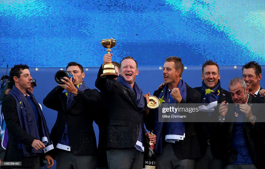 Jamie Donaldson of Europe celebrates with the Ryder Cup trophy after the Singles Matches of the 2014 Ryder Cup on the PGA Centenary course at the...