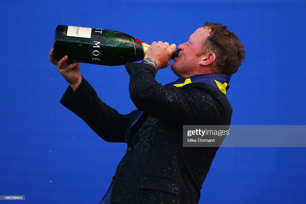 Jamie Donaldson of Europe drinks champagne after Europe won the Ryder Cup after the Singles Matches of the 2014 Ryder Cup on the PGA Centenary course...