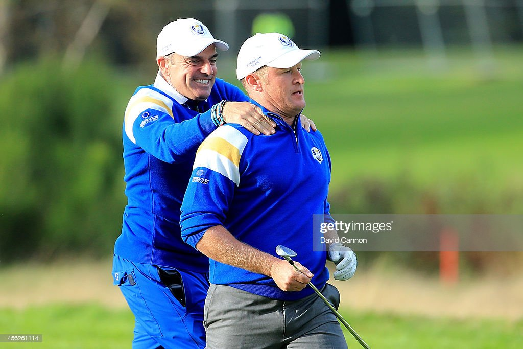 <a gi-track='captionPersonalityLinkClicked' href=/galleries/search?phrase=Jamie+Donaldson&family=editorial&specificpeople=241203 ng-click='$event.stopPropagation()'>Jamie Donaldson</a> of Europe is congratulated by Europe team captain Paul McGinley on the 15th hole shortly before Europe won the Ryder Cup after Donaldson defeated Keegan Bradley of the United States during the Singles Matches of the 2014 Ryder Cup on the PGA Centenary course at the Gleneagles Hotel on September 28, 2014 in Auchterarder, Scotland.