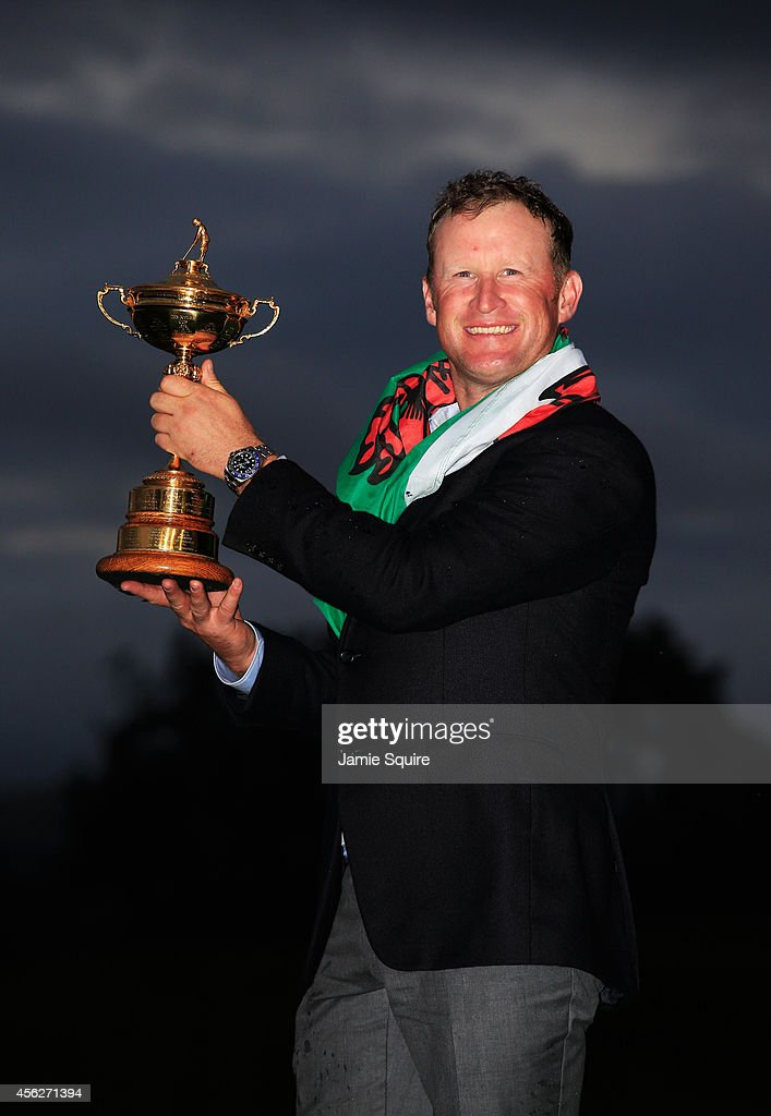 Jamie Donaldson of Europe poses with the Ryder Cup trophy after the Singles Matches of the 2014 Ryder Cup on the PGA Centenary course at the...