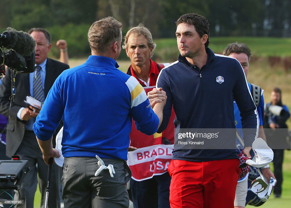 Jamie Donaldson of Europe shakes hands with Keegan Bradley of the United States on the 15th hole as Europe win the Ryder Cup during the Singles...