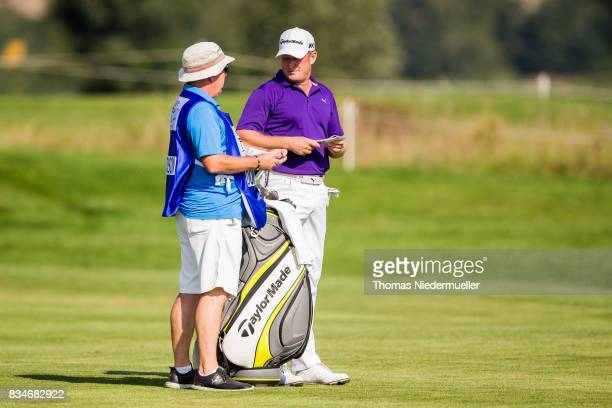 Jamie Donaldson of Wales and his caddie are seen during day two of the Saltire Energy Paul Lawrie Matchplay at Golf Resort Bad Griesbach on August 18...