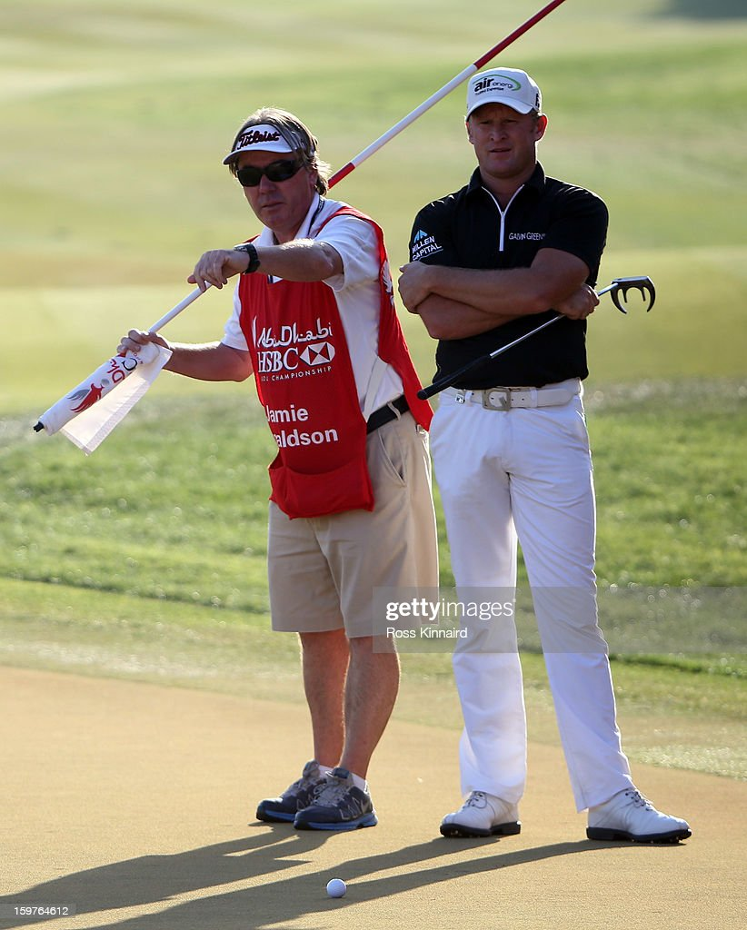 Jamie Donaldson of Wales and his caddie Michael Donaghy during the final round of the Abu Dhabi HSBC Golf Championship at the Abu Dhabi Golf Club on January 20, 2013 in Abu Dhabi, United Arab Emirates.