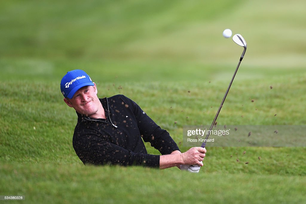 Jamie Donaldson of Wales hits his 3rd shot on the 4th hole during day one of the BMW PGA Championship at Wentworth on May 26, 2016 in Virginia Water, England.