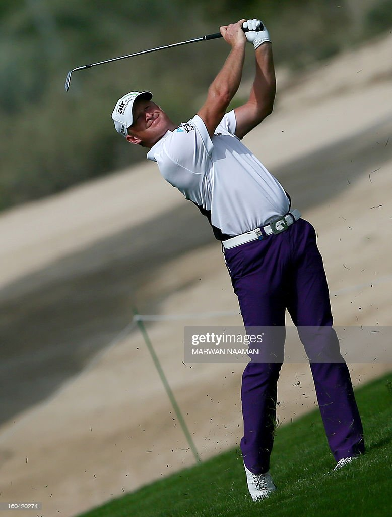 Jamie Donaldson of Wales hits off the tee box during the first round of the Dubai Desert Classic golf tournament in the Gulf emirate of Dubai on January 31, 2013.